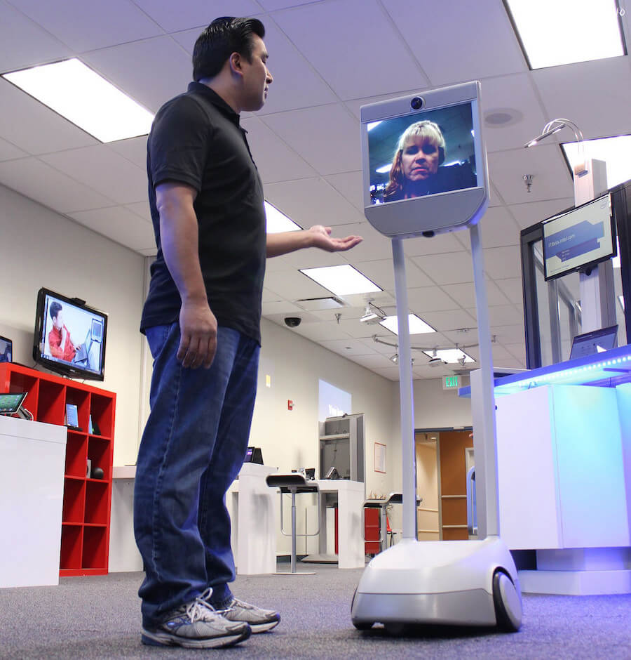 telepresence robot with man in office